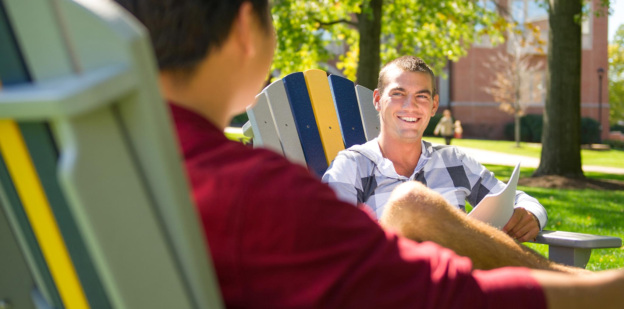 Students studying in Adirondack chairs